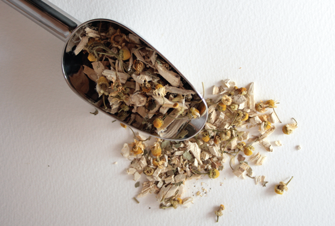 Picture of dried flowers in a measuring spoon